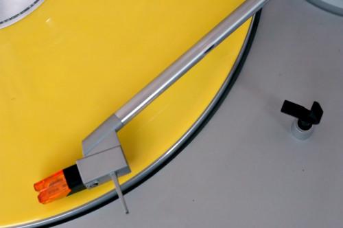 Yellow vinyl on a turntable